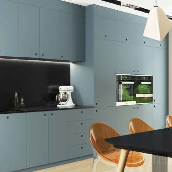 Blue kitchen cabinets with built in appliances in a modern space.