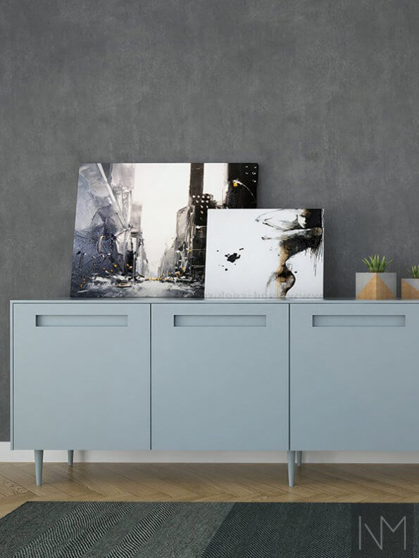 paintings on light powder blue cupboards
