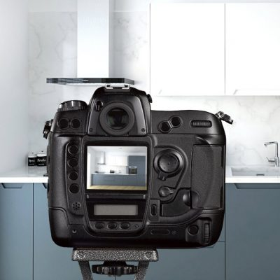 Camera set up to take picture of kitchen
